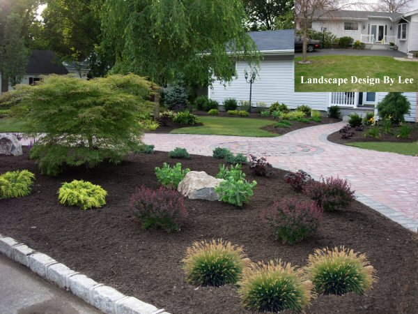 Landscaping ideas for a circular driveway driveway for Circular driveway landscaping pictures